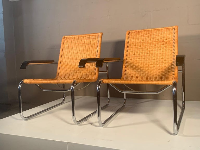 A beautiful pair of chrome and cane Marcel Breuer vintage armchairs. Made in West Germany, circa 1970s and distributed by ICF. Classic chairs that are comfortable and look good from every angle.