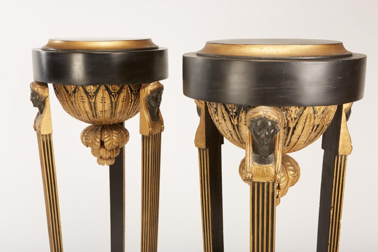 Neoclassical Pair of Continental Neoclassic Black Painted and Parcel-gilt Torcheres, Italian For Sale