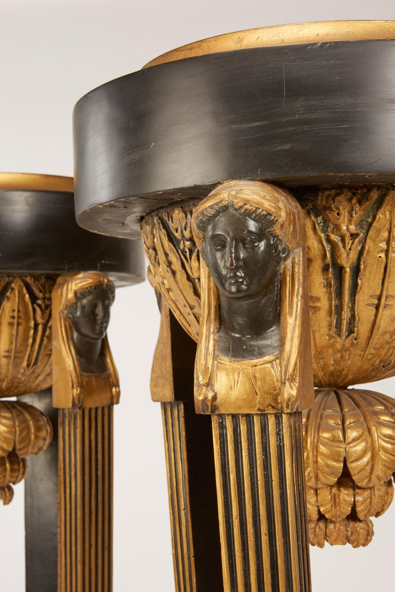 Mid-19th Century Pair of Continental Neoclassic Black Painted and Parcel-gilt Torcheres, Italian For Sale