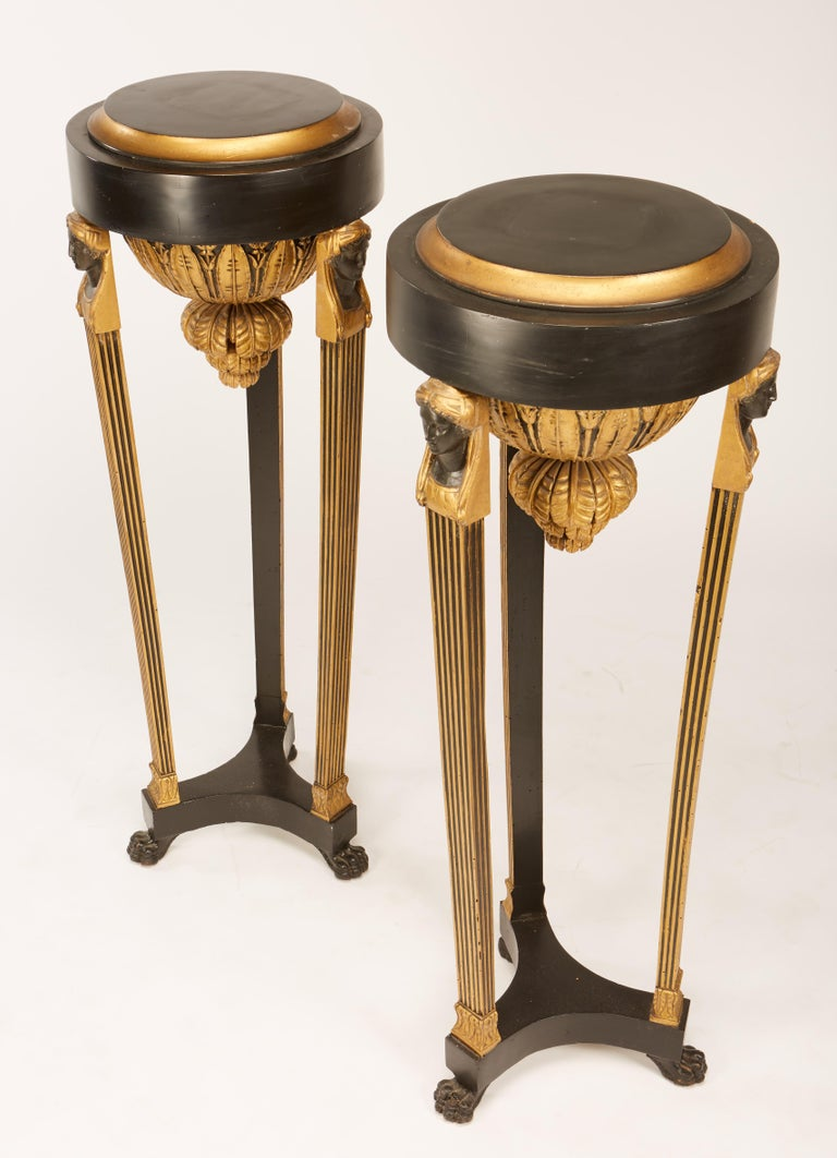 Pair of Continental Neoclassic Black Painted and Parcel-gilt Torcheres, Italian For Sale 2