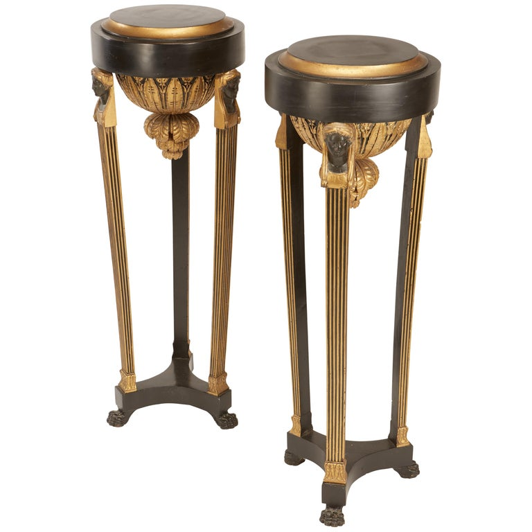 Pair of Continental Neoclassic Black Painted and Parcel-gilt Torcheres, Italian For Sale