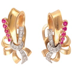 Pair of Diamond and Ruby Scroll Earclips, circa 1940