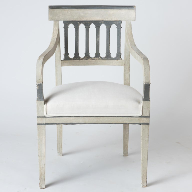 """These stylish chairs have a graphic combination of original grey and white paint. They feature an openwork back with a Gothic feel. The seats have been newly upholstered in a French linen fabric. $5,200 Measures: 35.5"""" high 21.75"""" wide 18"""""""