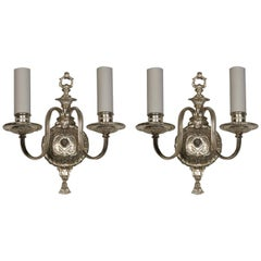 A pair of double-light silverplate sconces