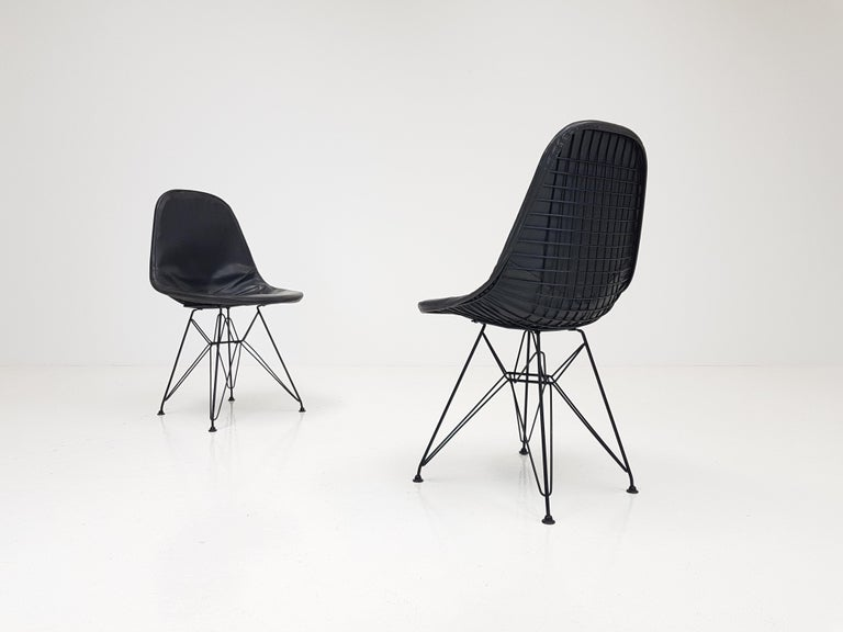 A pair of early Charles & Ray Eames DKR chairs with original vinyl cover, circa 1950s.