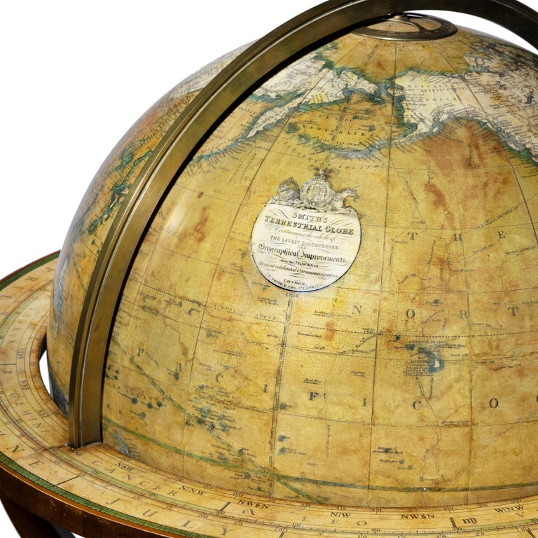 A pair of early Victorian 18 inch globes by Smith & Son, each set into a turned mahogany stand on three cabriole legs centred on compass roses, the terrestrial globe stating 'Smith's terrestrial globe containing the whole of the latest discoveries