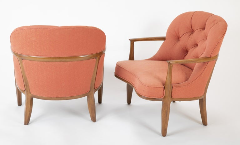 A pair of model 5705 walnut armchairs designed by Edward Wormley for Dunbar. Part of what many consider to be Wormley's finest collection of furniture, mid-20th century.