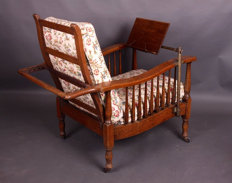Pair of Edwardian Oak Steamer Chairs, One with a Carters Patent Reading  Stand For Sale - Pair Of Edwardian Oak Steamer Chairs, One With A Carters Patent