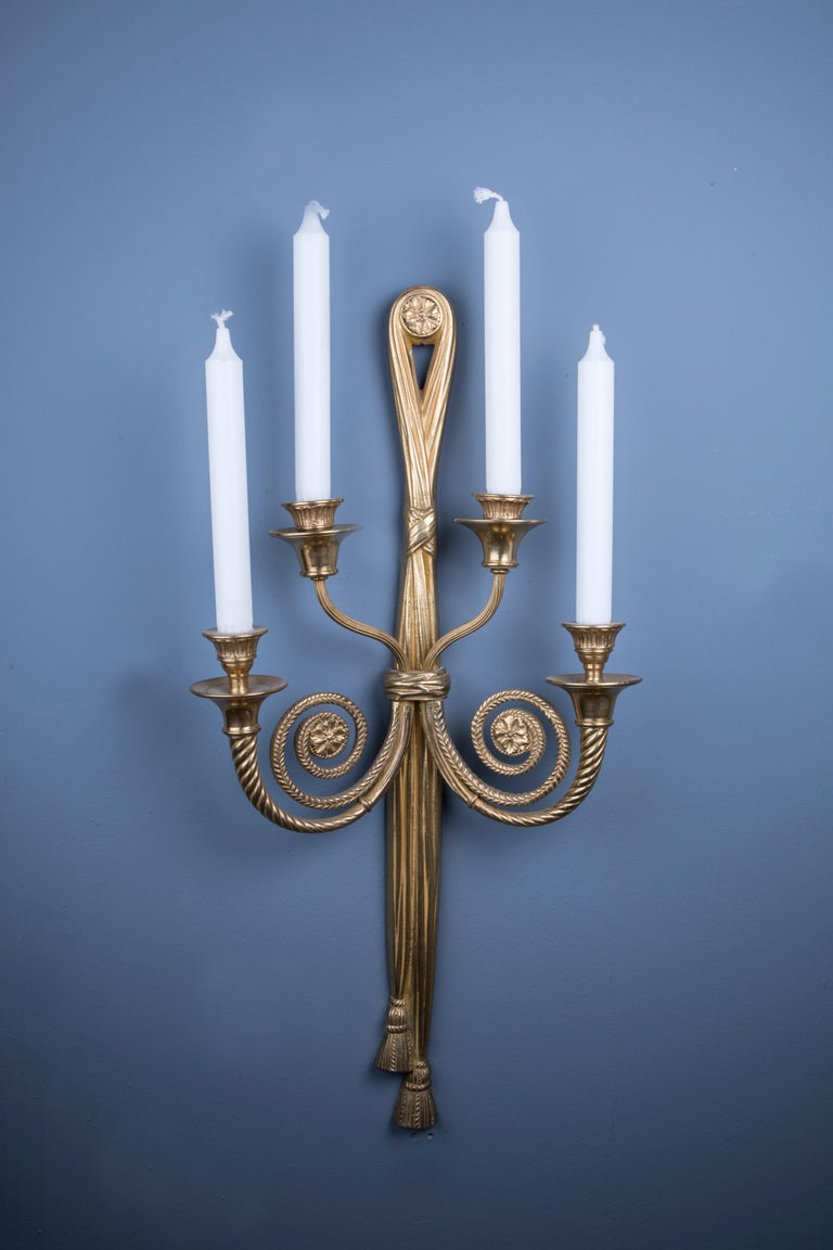 A pair of bronze candle holding wall lights with 2 barley twist arms and ribbon drape beneath. Can be electrified for European or North American use at no extra cost.