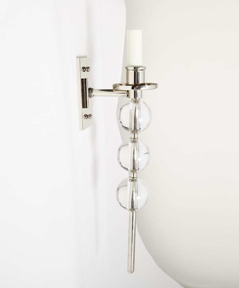 A pair of our custom-designed Ephorus sconces with over-scaled Murano glass balls, polished nickel finish, rectangular backplates, and elongated center rod. Also available in brass, and with rock crystal balls. One candelabra socket per