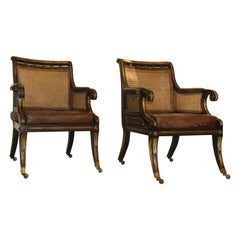 Pair of English Regency Style Ebonized and Gilt Library Chairs