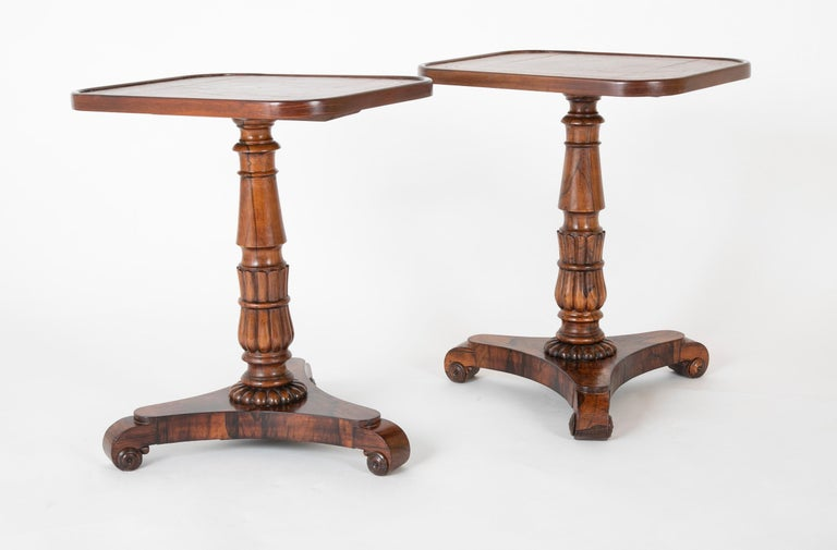 A pair of William IV gold tool leather top rosewood cocktail tables. English, circa 1840. Both tables with restorations.