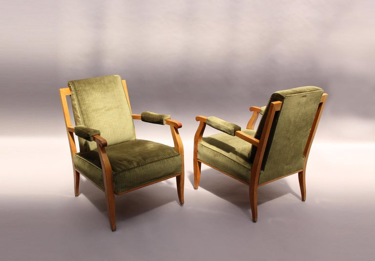 A pair of fine French Art Deco cherrywood armchairs by Jules Leleu.