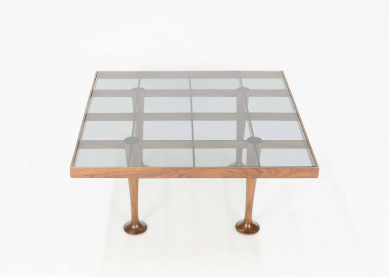 These Finely detailed pieces are from the Italain period of haute modern design period.  The tables are perfect for the living room or elegant bed side tables.  They can be put side by side and form  an extra long coffee table.  The smiked glass is