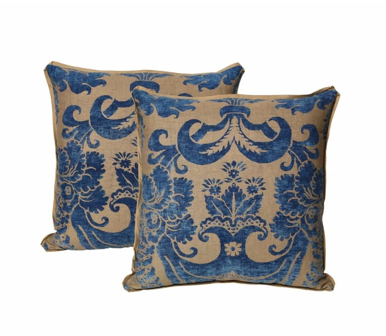 A pair of vintage Fortuny fabric cushions in the Glicine pattern, blue and beige color way with bias edging and matching striped silk backs, the pattern, a 17th century Italian design with Wisteria motif