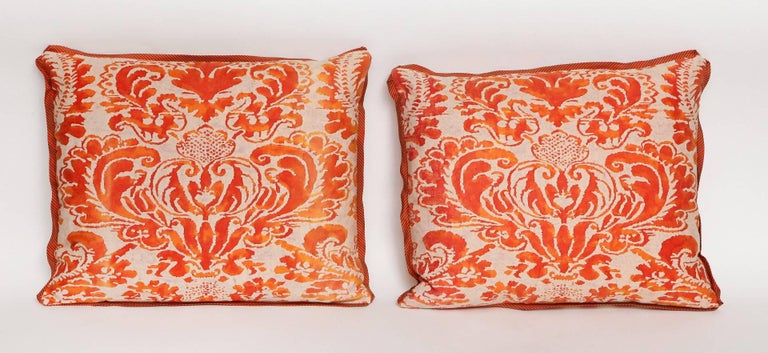 A pair of Fortuny fabric cushions in the Sevigne pattern, rectangular shape with bias silk edging and striped silk backing, the pattern, a 17th century French designed named after Madame de Sevigne 