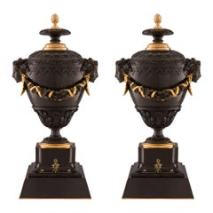 Pair of French 19th Century Charles X Style Marble, Bronze and Ormolu Urns