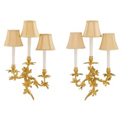 Pair of French 19th Century Louis XV Style Ormolu Three Arms Sconces