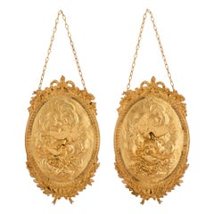A pair of French 19th century Louis XVI st. ormolu wall plaques