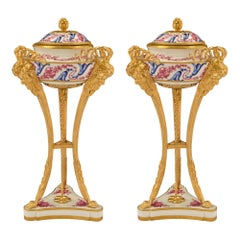 Pair of French 19th Century Louis XVI St. Sèvres Porcelain and Ormolu Urns