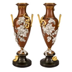 Pair of French 19th Century Louis XVI Style Two-Toned Bronze and Ormolu Urns