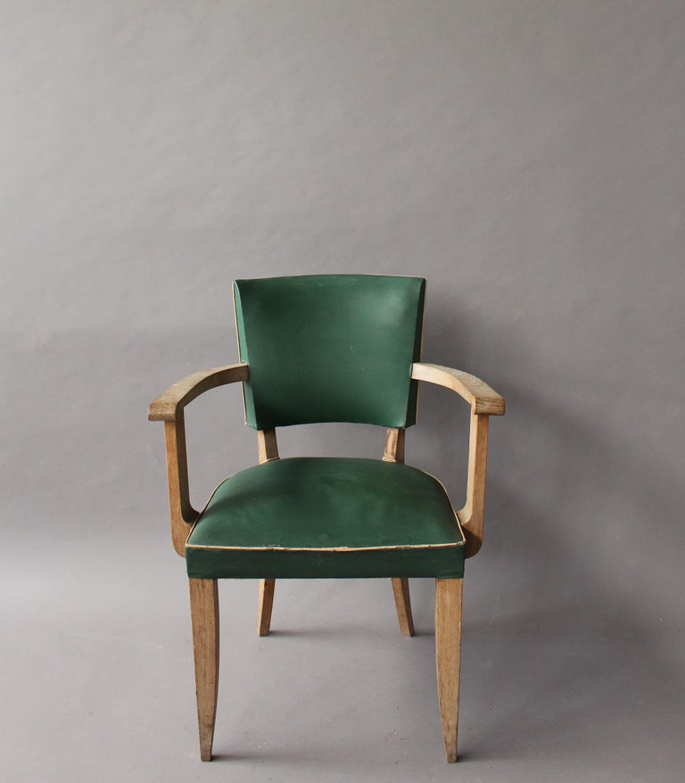 A pair of French 1930s beech bridge / office chairs.