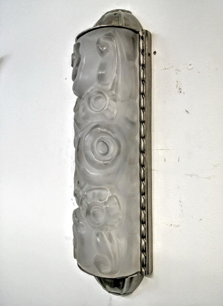 Cast Pair of French Art Deco Wall Sconces by Genet et Michon For Sale