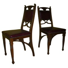Pair of French Art Nouveau Oak Dining Chairs with Whiplash Side Stretchers