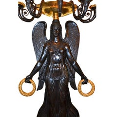 Pair of French Empire Style Patinated and Gilt Bronze Victory Sconces