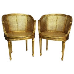 Pair of French Louis XVI Style Giltwood Carved and Cane Fauteuils Armchairs