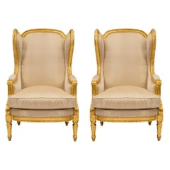 Pair of French Mid-19th Century Louis XV Style Giltwood Bergère Armchairs