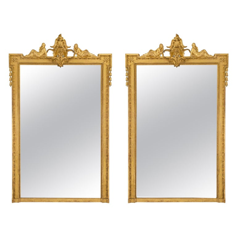 Pair of French Mid-19th Century Louis XVI Style Giltwood Mirrors For Sale