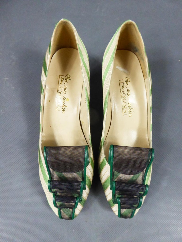 Circa 1960/1970 France  Pretty pairs of heels in striped silk in the shades of cream, green and gold with small black heels. Shaped silk with satin bands and cream faille. Rounded ends embellished with a strip of rigid plastic tulle surronded with