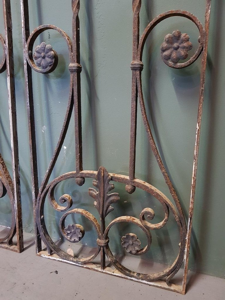 Set old French wrought iron door grilles decorated with twisted and curled elements, both are in good but used condition. Originating from the 1st half of the 20th century.  The measurements are, Depth 2 cm/ 0.7 inch. Width 34 cm/ 13.3
