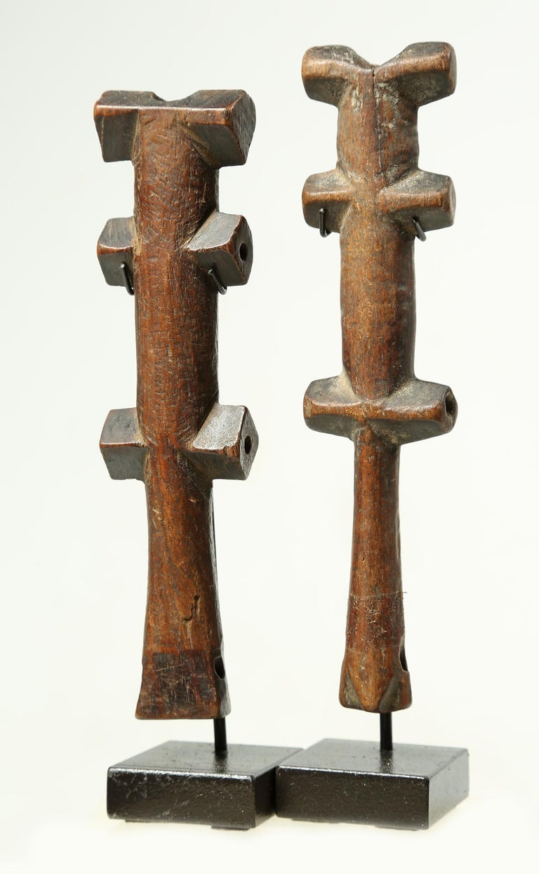 An elegant and harmonic set. A pair of old and finely crafted geometric flutes from the Mossi people, Burkina Faso, Africa, early 20th century. With stacked geometric shapes, this pair of end-blown flutes make a simple elegant statement. Wear and