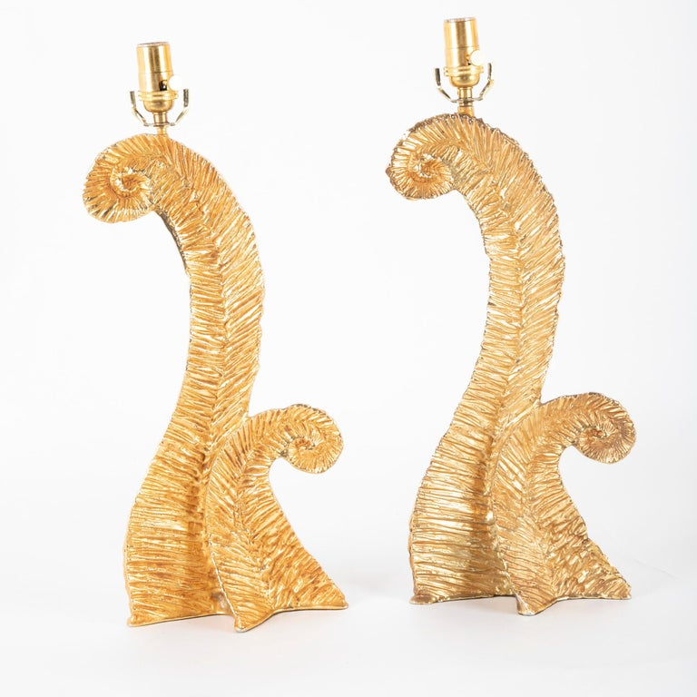 Pair of lamps in gilt metal presumed to be made by Fondica and designed by Pierre Casenove.