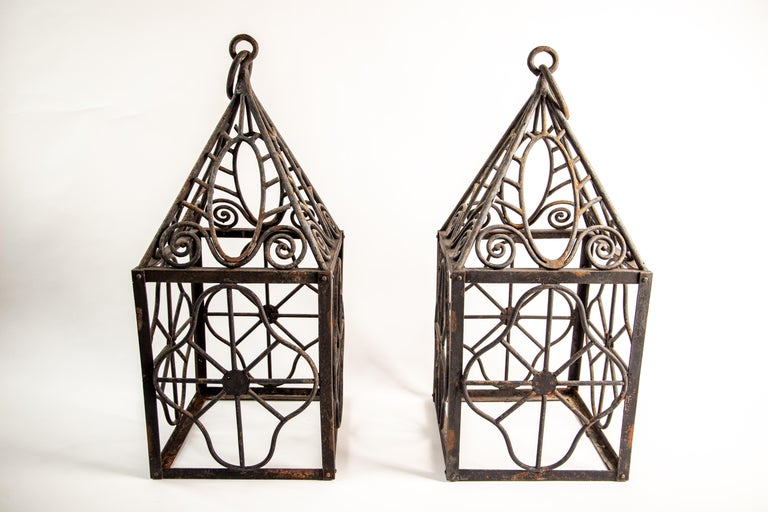 Art Deco Pair of grand scale wrought iron hurricane lanterns in the style of Edgar Brandt For Sale