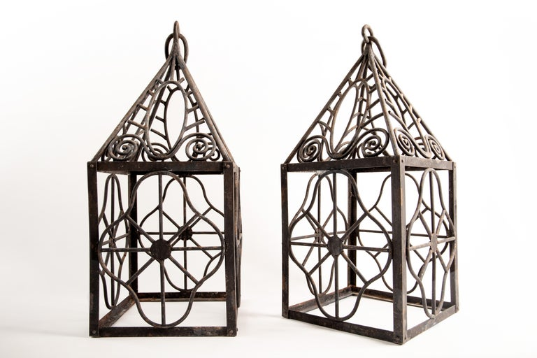 French Pair of grand scale wrought iron hurricane lanterns in the style of Edgar Brandt For Sale