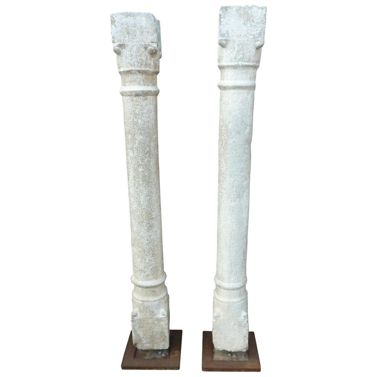 A Pair of Granite Pillars on Stabile Weathering Steel Stands For Sale