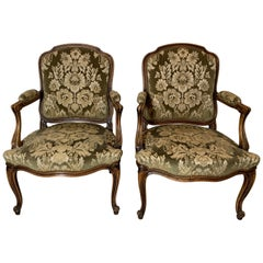 A Pair of hand carved French Fauteils Arm Chairs