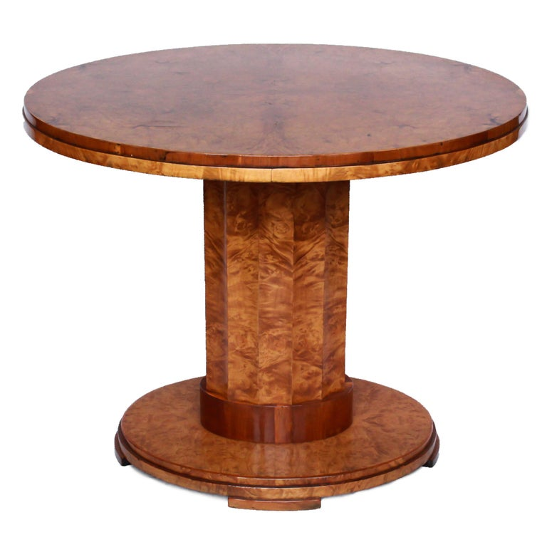 A pair of Art Deco, oval, centre tables by Harry & Lou Epstein. Veneered walnut with oval, fluted bases and central columns. 