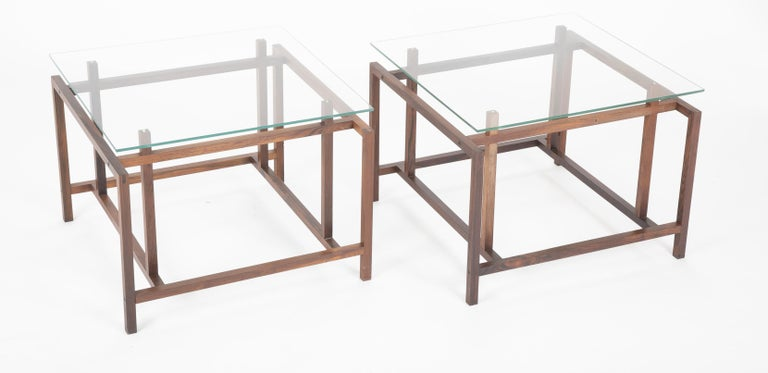 A pair of Henning Norgaard glass top rosewood side tables by Komfort Mobler, Denmark.