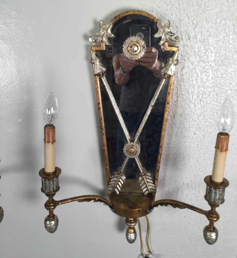 Gilt Pair of Hollywood Regency Style Mirrored Sconces For Sale