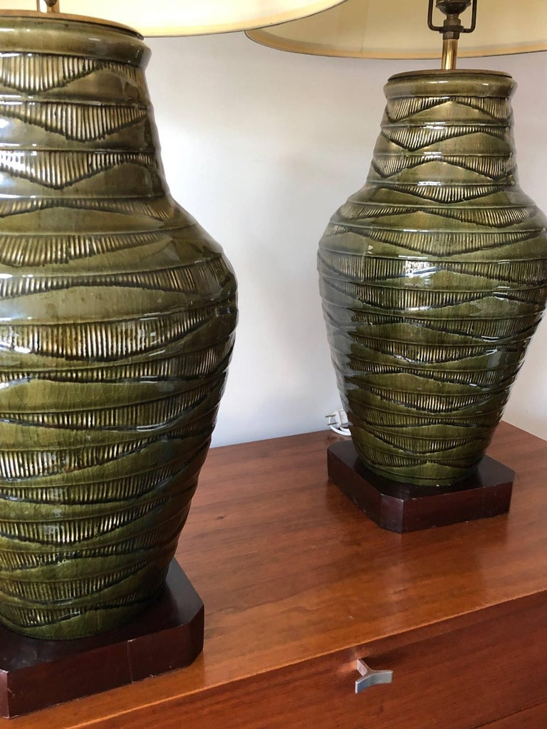 A pair of large-scale green Thai Celadon-marked  lamps. Ceramic/porcelain bases measure approx. 18