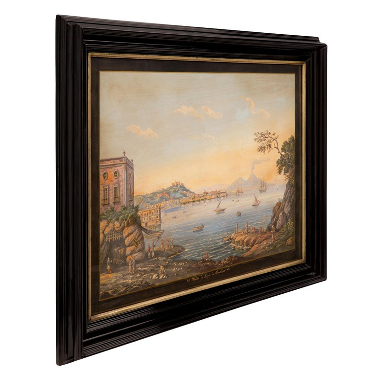 A striking and most decorative pair of Italian 19th century Louis XVI style gouaches in their original ebonized fruitwood and Mecca frames. Each gouache is framed within elegant ebonized fruitwood borders with fine mottled designs and lovely Mecca