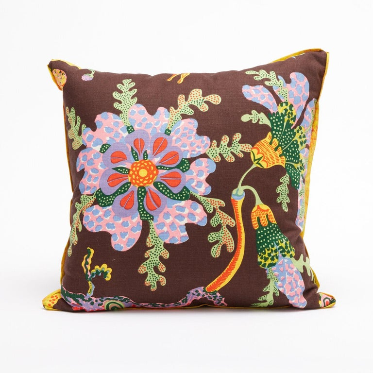 A pair of cushions featuring vintage fabric by Austrian designer Josef Frank. Each cushion displays a design motif from Josef Frank's