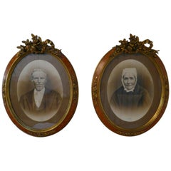 Pair of Large Portrait Photographs in Oval Ormolu Frames