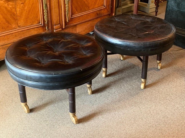 Mid-20th Century A Pair of Large Round Leather Ottomans by Baker For Sale