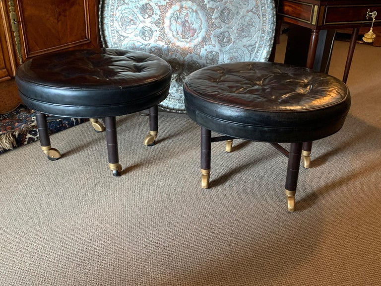 A Pair of Large Round Leather Ottomans by Baker For Sale 2