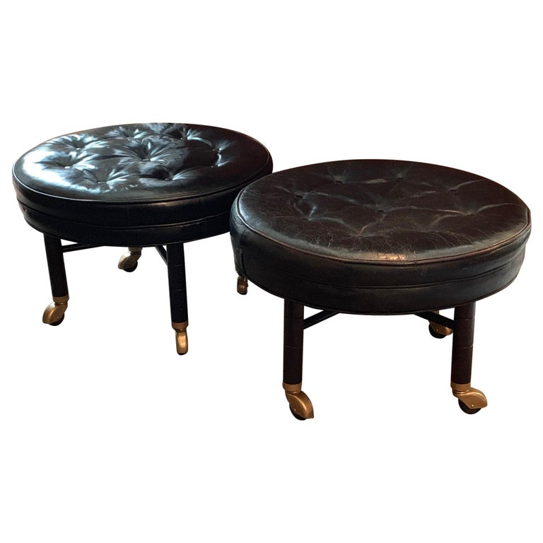 A Pair of Large Round Leather Ottomans by Baker For Sale